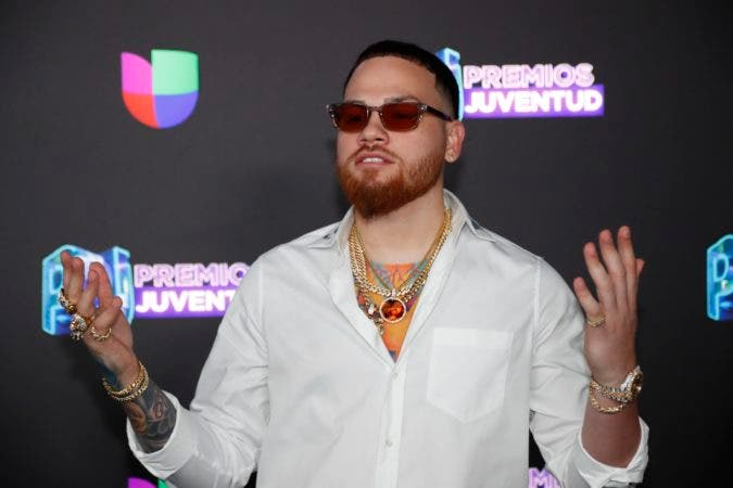 7. Puerto Rican rapper Miky Woodz poses for a photo as he walks the red carpet before the Premios Juventud 2019, Latin awards show, Thursday, July 18, 2019, in Coral Gables, Fla. (AP Photo/Wilfredo Lee)