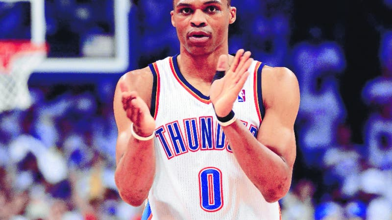 OKLAHOMA CITY, OK - JUNE 06: Russell Westbrook #0 of the Oklahoma City Thunder reacts after a play against the San Antonio Spurs in Game Six of the Western Conference Finals of the 2012 NBA Playoffs at Chesapeake Energy Arena on June 6, 2012 in Oklahoma City, Oklahoma. NOTE TO USER: User expressly acknowledges and agrees that, by downloading and or using this photograph, User is consenting to the terms and conditions of the Getty Images License Agreement.   Ronald Martinez/Getty Images/AFP== FOR NEWSPAPERS, INTERNET, TELCOS & TELEVISION USE ONLY ==