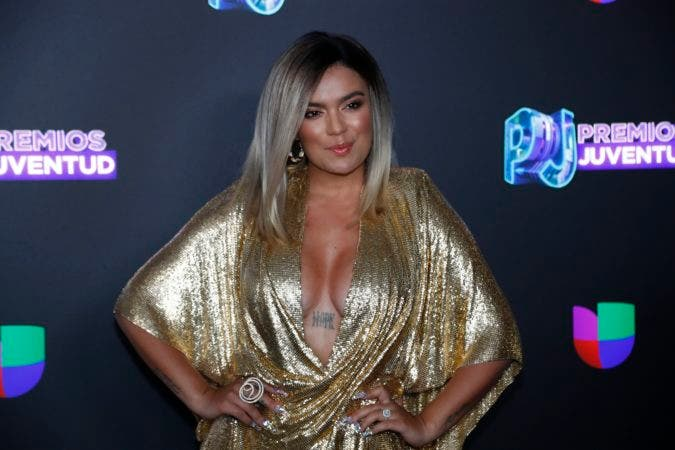 6. Colombian singer Karol G poses for a photo as she walks the red carpet before the Premios Juventud 2019, Latin awards show, Thursday, July 18, 2019, in Coral Gables, Fla. (AP Photo/Wilfredo Lee)
