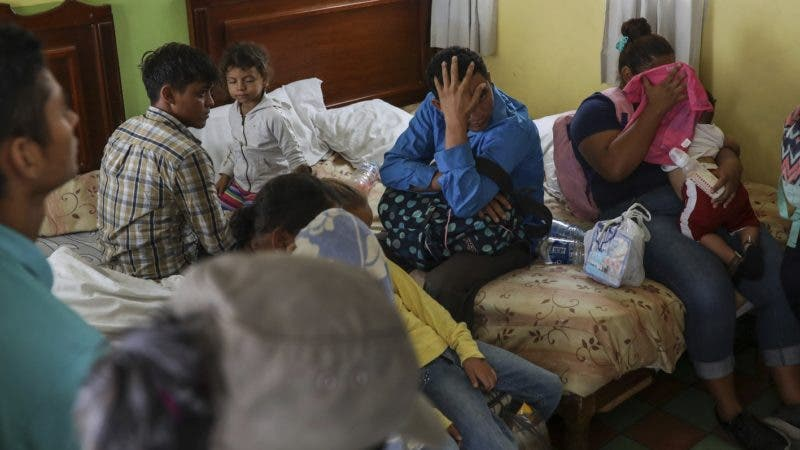 Central American migrants sit together inside a room at the Latino hotel during a raid by Mexican immigration agents in Veracruz, Mexico, Thursday, June 27, 2019.  Mexican police, soldiers and National Guard have recently been raiding hotels, buses and trains to round up migrants, creating scenes that have caused an outcry in the United States, but in Mexico there has been little backlash despite the historical sympathy for the plight of migrants.(AP Photo/Felix Marquez)