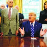 President Donald Trump, accompanied by Apollo 11 astronauts Micheal Collins, left, and Buzz Aldrin, right, with Vice President Mike Pence and first lady Melania Trump, speaks during a photo opportunity commemorating the 50th anniversary of the Apollo 11 moon landing, in the Oval Office of the White House, Friday, July 19, 2019, in Washington. (AP Photo/Alex Brandon)