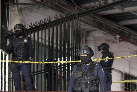 Officers with the State Police of Guerrero and Municipal Police of Acapulco guard an area near a popular bar where gunmen killed and wounded multiple people in Acapulco, Mexico, Sunday July 21, 2019. (AP Photo/Bernardino Hernandez)