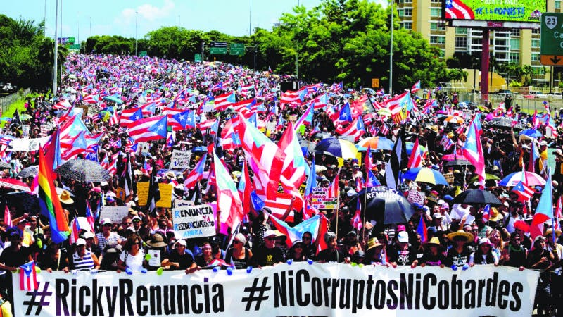 Demonstrators march on Las Americas highway demanding the resignation of governor Ricardo Rossello, in San Juan, Puerto Rico, Monday, July 22, 2019. Protesters are demanding Rossello step down for his involvement in a private chat in which he used profanities to describe an ex-New York City councilwoman and a federal control board overseeing the island's finance. (AP Photo/Carlos Giusti)