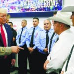 President Donald Trump speaks to first responders as he visits the El Paso Regional Communications Center after meeting with people affected by the El Paso mass shooting, Wednesday, Aug. 7, 2019, in El Paso, Texas. (AP Photo/Evan Vucci)