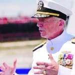 "FILE - In this  July 27, 2019 file photo, Admiral Craig Faller, commander of U.S. Southern Command, speaks with the news media following a commissioning ceremony for the U.S. Navy's guided missile destroyer, the USS Paul Ignatius, at Port Everglades in Fort Lauderdale, Fla. Faller said on Monday, Aug. 19, 2019 that military officials are focusing on preparing for ""the day after"" once ""isolated"" Venezuelan President Nicolás Maduro leaves power. (AP Photo/Lynne Sladky, File)"