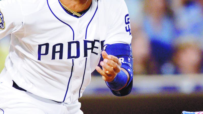 San Diego Padres' Fernando Tatis Jr. watches his triple during the eighth inning of the baseball game against the Colorado Rockies, Saturday, Aug. 10, 2019, in San Diego. (AP Photo/Orlando Ramirez)