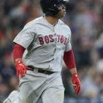 Boston Red Sox's Rafael Devers watches his home run against the Houston Astros during the fourth inning of a baseball game Sunday, May 26, 2019, in Houston. (AP Photo/David J. Phillip)