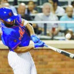 New York Mets' Amed Rosario hits a single during the seventh inning of the second baseball game of a doubleheader against the Miami Marlins,Thursday, Sept. 13, 2018, in New York. (AP Photo/Frank Franklin II)