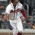 Atlanta Braves' Ronald Acuna Jr. watches his single against the Miami Marlins in the ninth inning of a baseball game Thursday, Aug. 22, 2019, in Atlanta. (AP Photo/Tami Chappell)