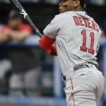 Boston Red Sox's Rafael Devers watches his RBI double during the first inning of the team's baseball game against the Cleveland Indians, Tuesday, Aug. 13, 2019, in Cleveland. (AP Photo/Tony Dejak)