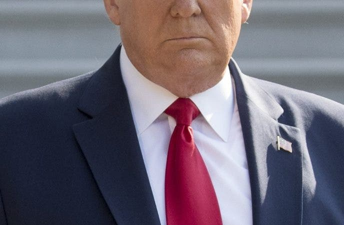 President Donald Trump walks towards members of the media on the South Lawn of the White House in Washington, Wednesday, Aug. 7, 2019, before boarding Marine One for a short trip to Andrews Air Force Base, Md., and then on to Dayton, Ohio, and El Paso, Texas, in the afternoon to praise first responders and console family members and survivors from two recent mass shootings. (AP Photo/Andrew Harnik)