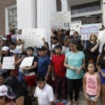 Children of mainly Latino immigrant parents hold signs in support of them and those individuals picked up during an immigration raid at a food processing plant, during a protest march to the Madison County Courthouse in Canton, Miss., following a Spanish Mass at Sacred Heart Catholic Church in Canton on Sunday, Aug. 11, 2019. Even as President Donald Trump and local Republican allies defend the raids, churches are emerging as sources of spiritual and material aid to the migrants. At some churches, the response is also flaring into political opposition. (AP Photo/Rogelio V. Solis)