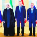 Ankara (Turkey), 16/09/2019.- (L-R) Iranian President Hassan Rouhani, Turkish President Recep Tayyip Erdogan and Russian President Vladimir Putin pose for a picture during their meeting in Ankara, Turkey, 16 September 2019. The leaders of Russia, Iran and Turkey meet in the Turkish capital to negotiate on a long-term settlement in Syria. (Rusia, Siria, Turquía) EFE/EPA/PAVEL GOLOVKIN/POOL