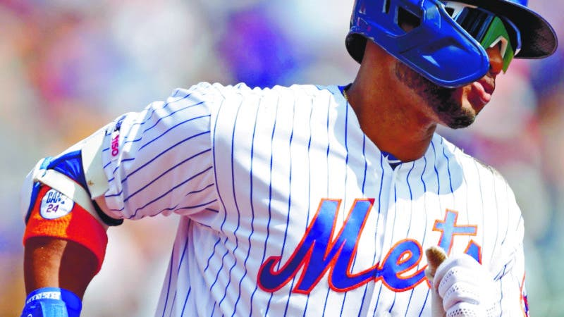 New York Mets' Robinson Cano trots the bases after hitting a solo home run in first inning of a baseball game against the Philadelphia Phillies, Sunday, Sept. 8, 2019, in New York. (AP Photo/Kathy Willens)