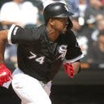 Chicago White Sox's Eloy Jimenez watches his RBI single off Kansas City Royals starting pitcher Jorge Lopez during the third inning of a baseball game Thursday, Sept. 12, 2019, in Chicago. Yoan Moncada scored on the play. (AP Photo/Charles Rex Arbogast)