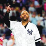 Bronx (United States), 18/09/2019.- New York Yankees starting pitcher CC Sabathia raises his cap to the crowd after being taken out of the ball game during his team'Äôs game against the Los Angeles Angels in the third inning of the MLB game between the Los Angeles Angels and the New York Yankees at Yankee Stadium in the Bronx, New York, USA, 18 September 2019. (Estados Unidos, Nueva York) EFE/EPA/JASON SZENES