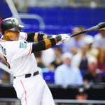 Miami Marlins' Starlin Castro hits a three-run home run during the fifth inning of a baseball game against the Atlanta Braves Tuesday, July 24, 2018, in Miami. The Marlins defeated the Braves 9-3. (AP Photo/Brynn Anderson)