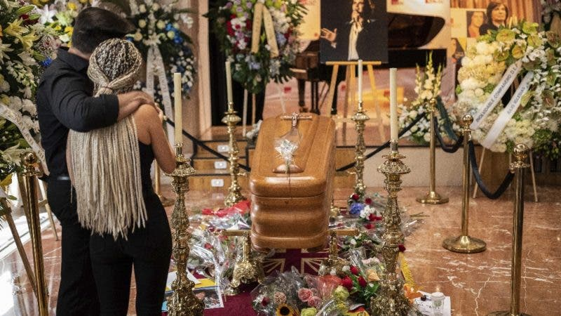 Well wishers pass by the coffin of Spanish singer and songwriter Camilo Sesto in Madrid, Monday, Sept. 9, 2019. Spanish singer and songwriter Camilo Sesto, a popular star in the 1970s and 1980s, died on Sunday Sept. 8, of heart failure. Sesto, whose real name was Camilo Blanes Cortes, sold more than 100 million records worldwide over his 40-year career. (AP Photo/Bernat Armangue)