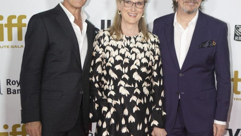 Meryl Streep stands with Gary Oldman, right, and Antonio Banderas at the Toronto International Film Festival Tribute Gala, a fundraiser that highlights standout creators in the film industry, in Toronto on Monday, Sept. 9, 2019.  (Chris Young/The Canadian Press via AP)