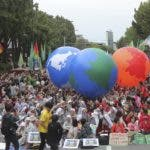 Environmental activists carry earth balloons during a rally demanding action in halting the climate crisis in Seoul, South Korea, Saturday, Sept. 21, 2019. Hundreds of activists attended a rally as a part of global climate strike ahead of a U.N. climate summit in New York. (AP Photo/Ahn Young-joon)