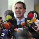 FILE - In this Sept. 3, 2019, file photo, Venezuela's opposition leader and self-proclaimed interim President of Venezuela, Juan Guaido, speaks to the press at the administrative headquarters of the National Assembly in Caracas, Venezuela. The Trump administration is more than tripling U.S. support for pro-democracy work in Venezuela and for the first time will give funds to Guaido as he attempts to set up an interim government. (AP Photo/Andrea Hernandez Briceño, File)