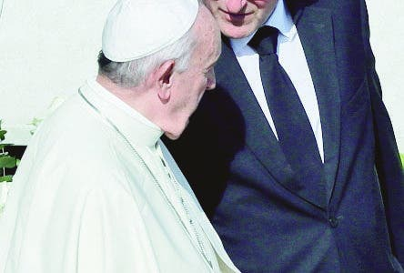 "Vatican head of security Domenico Giani, right, shares a word with Pope Francis at the end of a canonization Mass in St. Peter's Square at the Vatican, Sunday, Oct. 13, 2019. The Vatican said Monday Oct. 14, 2019 that Francis' chief bodyguard Giano has resigned over the leak of a Vatican police flyer identifying five Holy See employees who were suspended as part of a financial investigation, adding that Giano bore no responsibility for the leak, but that he had resigned to ensure the serenity of the investigation and ""out of love for the church and faithfulness"" to the pope.  (AP Photo/Alessandra Tarantino)"
