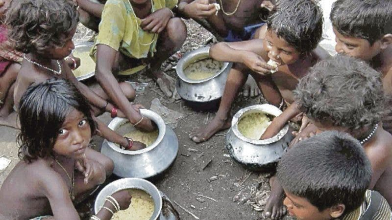Flood affected children from a neighboring village are seen, as they eat food provided by locals in Madhepura district in Bihar state, India, Wednesday, Sept. 3, 2008. Soldiers and aid workers pressed efforts Wednesday to rescue hundreds of thousands of people still stranded after weeks of flooding in northern India, as those safe on dry land settled in at camps that will likely house them for months. (AP Photo/Aftab Alam Siddiqui)
