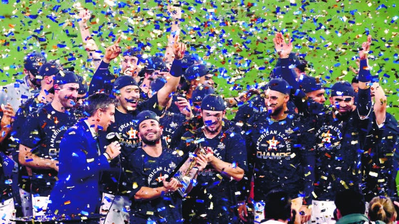 Houston (United States), 19/10/2019.- Houston Astros Jose Altuve (C) holds the National League Championship trophy after hitting a series-winning walk-off home run against the New York Yankees in the bottom of the ninth inning of their MLB American League Championship Series playoff baseball game six at Minute Maid Park in Houston, Texas, USA, 19 October 2019. The Astros will go on to face the Washington Nationals in the World Series. (Liga de Campeones, Estados Unidos, Nueva York) EFE/EPA/LARRY W. SMITH