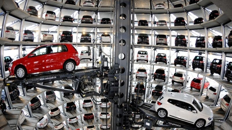 A red Volkswagen Golf (L) and a VW Scirocco are retrieved by an automated palette from a storage tower near the company's main factory in the northern German city of Wolfsburg on March 12, 2009. Earlier Martin Winterkorn, CEO of German car maker Volkswagen (VW) addressed the company's annual press conference where he expressed the desire for his company to be number one in its sector by 2018.  AFP PHOTO  DDP / NIGEL TREBLIN    GERMANY OUT
