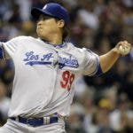 Los Angeles Dodgers starting pitcher Hyun-Jin Ryu throws during the first inning of a baseball game against the Milwaukee Brewers Wednesday, May 22, 2013, in Milwaukee. (AP Photo/Morry Gash)