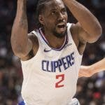 Los Angeles Clippers' Kawhi Leonard (2) reacts to being fouled as he drives to the basket against Dallas Mavericks' Maxi Kleber (42) during the first half of an NBA preseason basketball game Thursday, Oct. 17, 2019, in Vancouver, British Columbia. (Darryl Dyck/The Canadian Press via AP)