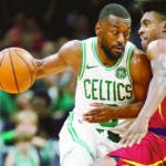 Cleveland Cavaliers' Collin Sexton (2) fouls Boston Celtics' Kemba Walker, left, during the first half of an NBA preseason basketball game in Boston, Sunday, Oct. 13, 2019. (AP Photo/Michael Dwyer)