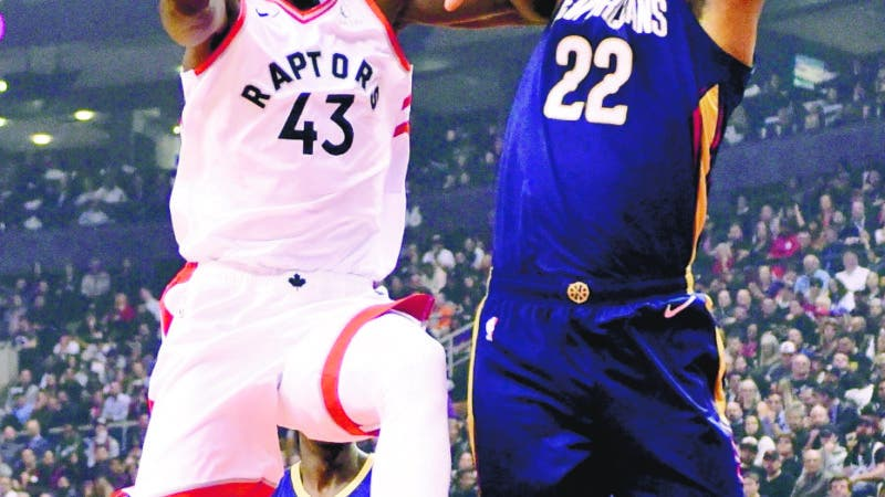 Toronto Raptors forward Pascal Siakam (43) drives to the basket as New Orleans Pelicans forward Derrick Favors (22) defends during the first half of an NBA basketball game Tuesday, Oct. 22, 2019, in Toronto. (Frank Gunn/The Canadian Press via AP)
