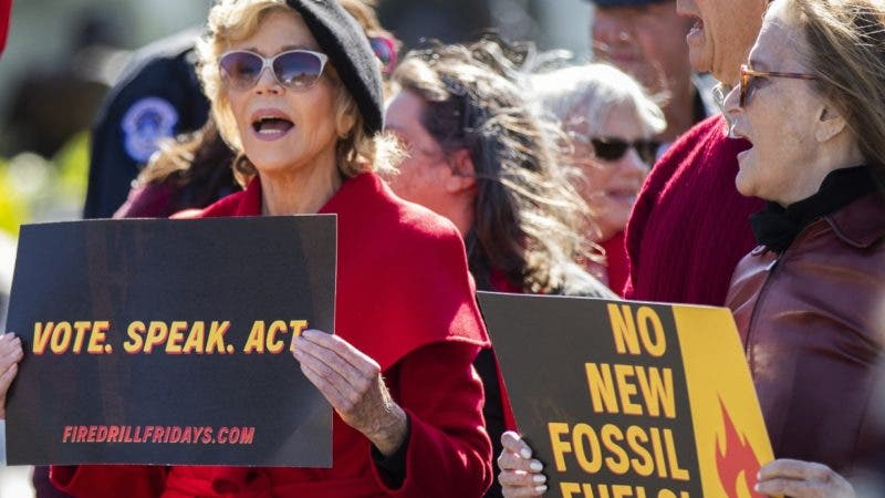 Sam Waterston, right, and Jane Fonda, center, march during a rally on Capitol Hill in Washington, Friday, Oct. 18, 2019. A half-century after throwing her attention-getting celebrity status into Vietnam War protests, Fonda is now doing the same in a U.S. climate movement where the average age is 18. (AP Photo/Manuel Balce Ceneta)