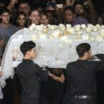 Members of the national ballet of Cuba carry the coffin of the late ballerina and choreographer Alicia Alonso during her wake while people say their final goodbyes, at the Alicia Alonso Grand Theater of Havana, Cuba, Saturday, Oct. 19, 2019. ( AP Photo/Ramon Espinosa)