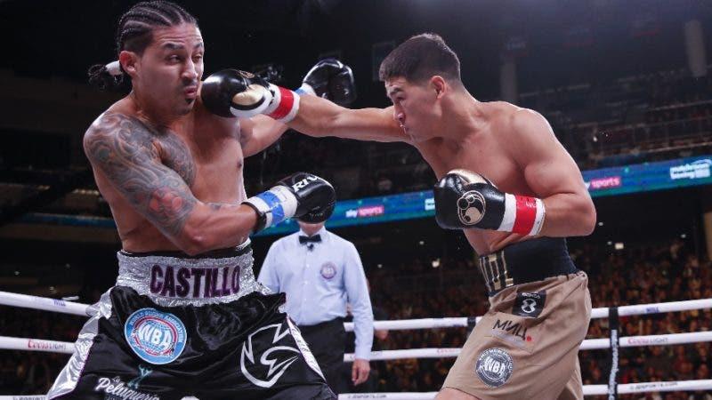 Dmitry Bivol, right, hits Lenin Castillo, left, during a light heavyweight boxing bout Saturday, Oct. 12, 2019, in Chicago. (AP Photo/Kamil Krzaczynski)