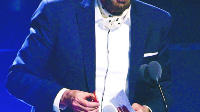 """Juan Luis Guerra accepts the award for best contemporary/tropical fusion album for """"Literal"""" at the 20th Latin Grammy Awards on Thursday, Nov. 14, 2019, at the MGM Grand Garden Arena in Las Vegas. (AP Photo/Chris Pizzello)"""