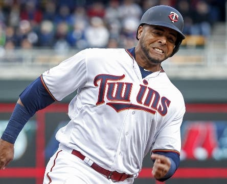 Minnesota Twins Nelson Cruz rounds third base on his way to scoring against the Cleveland Indians on a double by Marwin Gonzalez during a baseball game Thursday, March 28, 2019, in Minneapolis. The Twins won 2-0. (AP Photo/Bruce Kluckhohn)