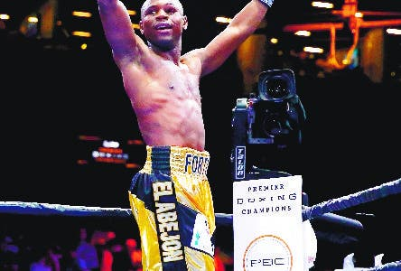 "NEW YORK, NY - MAY 29: Javier Fortuna celebrates his win against Bryan Vasquez winning the WBA ""regular"" junior lightweight title bout at Barclays Center of Brooklyn on May 29, 2015 in New York City.   Al Bello/Getty Images/AFP == FOR NEWSPAPERS, INTERNET, TELCOS & TELEVISION USE ONLY =="