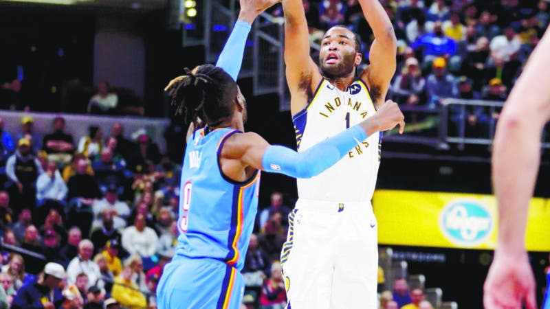 Indiana Pacers forward T.J. Warren (1) shoots over Oklahoma City Thunder forward Nerlens Noel (9) during the second half of an NBA basketball game in Indianapolis, Tuesday, Nov. 12, 2019. The Pacers won 111-85. (AP Photo/Michael Conroy)
