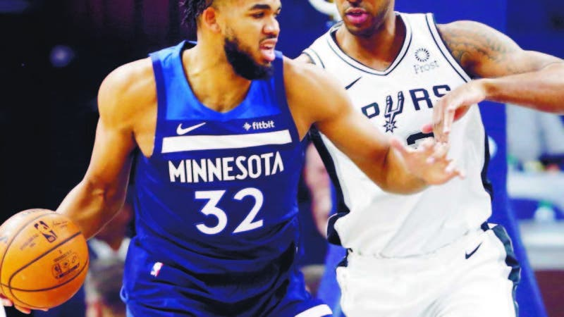 Minnesota Timberwolves' Karl-Anthony Towns, left, drives around San Antonio Spurs' LaMarcus Aldridge in the first half of an NBA basketball game Wednesday, Nov 13, 2019, in Minneapolis. (AP Photo/Jim Mone)