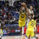 New Orleans Pelicans guard Kenrich Williams (34) reaches for the ball from Golden State Warriors center Willie Cauley-Stein (2) in front of New Orleans Pelicans center Jaxson Hayes (10) and Golden State Warriors forward Glenn Robinson III (22) in the second half of an NBA basketball game in New Orleans, Sunday, Nov. 17, 2019. The Pelicans won 108-100. (AP Photo/Tyler Kaufman)