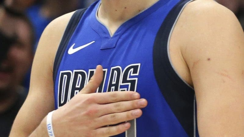 Dallas Mavericks forward Luka Doncic slaps his chest after hitting a three-point basket against the San Antonio Spurs in the second half in an NBA basketball game Monday, Nov. 18, 2019, in Dallas. (AP Photo/Richard W. Rodriguez)