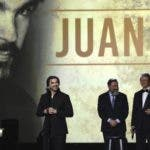 Juanes accepts his award at the Latin Recording Academy Person of the Year gala in his honor at the MGM Conference Center on Wednesday, Nov. 13, 2019, in Las Vegas. Looking on from right are Gabriel Abaroa, president and CEO of the Latin Recording Academy, and Jesus Lopez, Universal Music LATAM Chairman. (Photo by Chris Pizzello/Invision/AP)