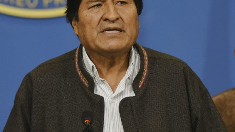 In this photo provided by the Agencia Boliviana de Informacion, Bolivian President Evo Morales speaks from the presidential hangar in El Alto, Bolivia, Sunday, Nov. 10, 2019. Bolivia's military chief Gen. Williams Kaliman said that President Evo Morales should resign so that stability can be restored after weeks of protests over his disputed election. He stepped in after Morales agreed earlier in the day to hold a new election. (Enzo De Luca/Agencia Boliviana de Informacion via AP)