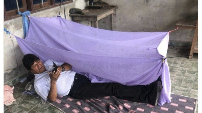 """This screen grab of a tweet posted on the account of Bolivia's former President Evo Morales on Monday, Nov. 11, 2019, shows him lying on the floor at an undisclosed location and a text that reads in Spanish """"This was my first night after leaving the presidency forced by a coup by Mesa and Camacho with the help of the police. I remembered my times as leader. I'm grateful to my brothers from the of Cochabamba tropic's federations for providing us with security and care."""" Morales resigned to the presidency on Nov 10, under mounting pressure from the military and the public after a disputed re-election victory that triggered weeks of fraud allegations and deadly protests. (AP Photo)"""