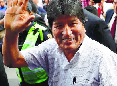 Bolivia's former President Evo Morales waves upon arrival to meet Claudia Sheinbaum, mayor of Mexico City, in Mexico City, Wednesday, Nov. 13, 2019. Mexico has granted asylum to Morales, who resigned on Nov. 10th under mounting pressure from the military and the public after his re-election victory triggered weeks of fraud allegations and deadly protests. (AP Photo/Marco Ugarte)