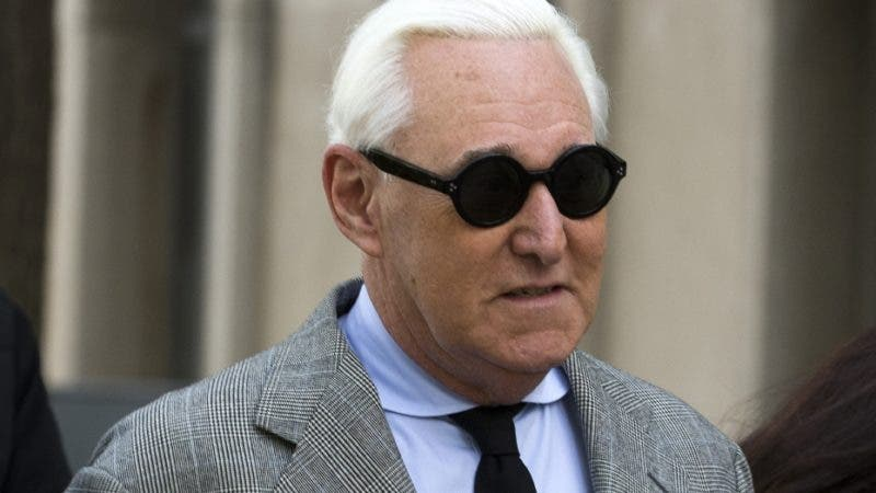 FILE - In this Nov. 14, 2019 file photo, Roger Stone accompanied by his wife Nydia Stone, right, arrives at federal court in Washington. Stone, a longtime friend and ally of President Donald Trump, has been found guilty at his trial in federal court in Washington. Stone was convicted Friday, Nov. 15. He was charged in a seven-count indictment that alleged he lied to lawmakers about WikiLeaks, tampered with witnesses and obstructed a House intelligence committee probe. (AP Photo/Jose Luis Magana, File)