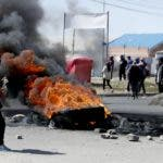 Supporters of former President Evo Morales burn tires in El Alto, on the outskirts of La Paz, Bolivia, Tuesday, Nov. 19, 2019. At least one person was killed Tuesday in clashes between Bolivian security forces and Morales' backers at the Senkata filling plant in El Alto. (AP Photo/Natacha Pisarenko)