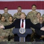 President Donald Trump, center, with Afghan President Ashraf Ghani and Joint Chiefs Chairman Gen. Mark Milley, behind him at right, while addressing members of the military during a surprise Thanksgiving Day visit, Thursday, Nov. 28, 2019, at Bagram Air Field, Afghanistan. (AP Photo/Alex Brandon)